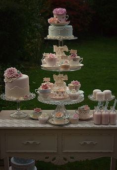 Love the cake to the left!! The cupcake tower topped with a small cake is awesome.