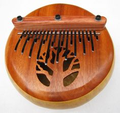 Kalimbas, also called thumb pianos, come from a family of instruments with a wide variety of names, Mbira is probably the most well known. They have their origin in many parts of Africa