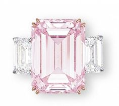 Christie's rare emerald cut pink diamond ring, 14.23 carats flanked by two diamonds. http://www.christies.com/features/2833_2103_e-1164-4.aspx