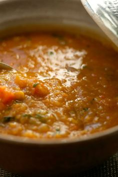 NYT Cooking: This is a lentil soup that defies expectations of what lentil soup can be. It is light, spicy and a bold red color (no murky brown here): a revelatory dish that takes less than an hour to make. The cooking is painless. Sauté onion and garlic in oil, then stir in tomato paste, cumin and chile powder and cook a few minutes more to intensify flavor. Add broth, w...