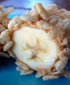 """Breakfast Sushi, banana covered in peanut butter, sliced into bite size pieces, and rolled in Rice Krispies."""