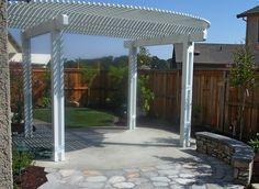 roseville-backyard-trellis-patio-cover-flagstone-patio-stone-seat-wall ...