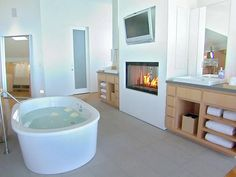 Free Standing Soaking Tub Paired with Fireplace   HGTVRemodels.com