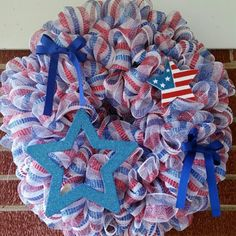 Handmade Red, White and Blue Door Wreath 12 inch wire wreath with 2 30 feet red white and blue mesh. 1 blue bow, 1 blue star and 1 flag. Great for the home or for your front door. Handmade Other