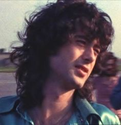 """Led Zeppelin """"A dreamy close-up of a tired Jimmy Page waiting to board Zeppelin's """"Starship"""" in 1973."""""""