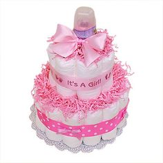 small girl's diaper cake with bottle topper