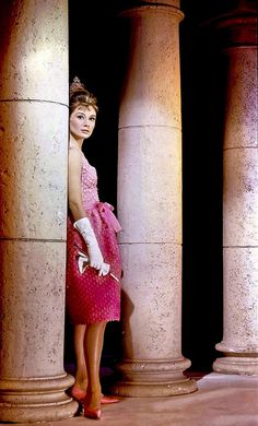 """Audrey Hepburn wearing the famous pink cocktail dress designed by Givenchy for the film """"Breakfast at Tiffany's"""" 1961"""