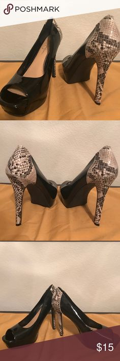 Jessica Simpson Size 8.5 Snake Print Heels Great shoes to go from business to after hour cocktails. The patent leather has very minor scuff marks and the Snake Print on the heel really make these interesting. Worn a couple of times, like new. Jessica Simpson Shoes Heels
