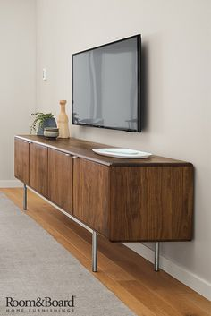 Add storage to your living room or family room with a modern media cabinet.