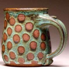 About 4.5 tall. Recently featured in Southern Living Magazine, these mugs are all individually wheel-thrown by Beth Mangum. The handles are pulled