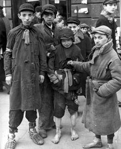 Warsaw, Poland, Children standing in a ghetto street. They are most probably smugglers or pick-pockets. All would be gassed later at death camp