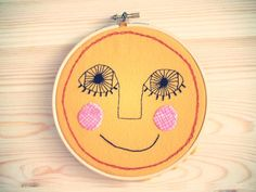 Hand embroidery hoop wall art. A sun ready to hang. One of a kind. $42.00, via Etsy.