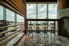 beautifully patterned floor in Google's Tel Aviv office, via Patternbooth blog