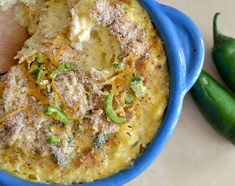 low-carb jalapeno spaghetti squash - 1 2.5 pound spaghetti squash, cut in half and seeded 1 1/3 cup 1/2&1/2 2 cloves garlic, minced 1/2 shallot, finely chopped 1 tablespoon butter 2 jalapeños, chopped and seeded 1/2 cup mozzarella cheese 1/2 cup cheddar cheese 2 tablespoons chopped jalapeños Liberal dashes of salt and pepper