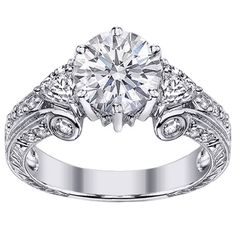 Vintage Diamond Engagement Ring LOVE this. I love vintage. just not as big as a diamond in the middle
