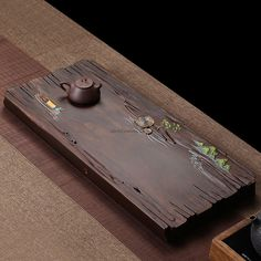 The tea tray, also known as the Chachuan (tea ship) and Chaxi (tea wash), it is a essencial item for gongfu tea and gongfu tea ceremony. This gongfu tea tray is used for brewing tea in the traditional Chinese Gong Fu style. It is used for carrying the tea set, tea and other tea accessories. Also you can pour the waste tea water on the tea tray directly, the tea tray has a pipe in the right lower corner to drain the waste water into a connected waste tea bucket. Tea Tray, Brewing Tea, Chinese Tea, Tea Accessories, Tea Ceremony, Traditional Chinese, Tea Sets, Woodworking, Hand Painted
