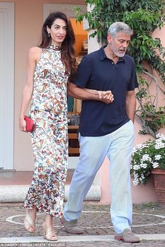 Make a style statement with a bold red clutch like Amal. Click 'Visit' to buy now. #amalclooney #alexandermcqueen #DailyMail #accessories