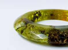 Resin ring with moss, lichen, and bark