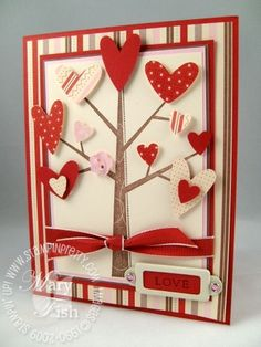Each heart is propped up on Stampin' Dimensionals.  TIP:  You can easily customize the shape of Stampin' Dimensionals with scissors.  I like to keep the dimensionals away from the edges of the adhered item so there is minimal exposure of the dimensionals from the side.  TIP:  I snuck in a Pink Pirouette flower button from Stampin' Up!'s Designer Button Bouquet for a little spice.The sentiment is from Fundamental Phrases, inked in Close to Cocoa and stamped on Riding Hood Red.  Two pink…