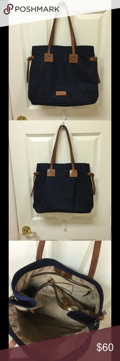 Dooney & Bourke Shoulder Bag Gently used Navy Blue nylon bag.  Excellent condition!  Cleaning out my closet.  No tears, ink marks, etc.  Magnetic snap closure. Dooney & Bourke Bags Shoulder Bags