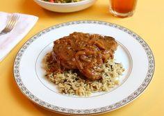 "Even though I've always found the name, ""smothered pork chops,"" a little unsettling, it's one of my favorite southern recipes. A beautiful c..."