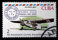 stamp printed in Cuba shows vintage airplane and devoted first passenger flight from Habana to Key West, stamp from series honoring 50 years of Cuban international AVIA post, circa 1977