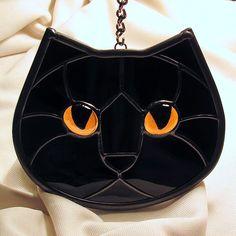 Stained Glass Black Cat Face Golden Eyes Suncatcher. $40.00, via Etsy.