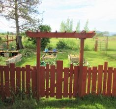 Patty Ann's DIY Garden Gate and Fencing Made from Leftover Lumber.