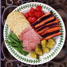 """Another #snackplate for #lunch today: oat crackers, cherry tomatoes, coloured carrot sticks, homemade cucumber pickles (I'll blog my recipe once I've finished the jar!), German salami"