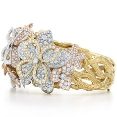 Diamond cuff in 18k yellow, white and rose gold.