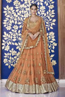 This gorgeous orange net embroidered lehenga by #Nakkashi is for just Rs.11648. #F2FShop #Frugal2Fab