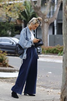See All The Best Street Style From Fashion Week Down Under #refinery29 www.refinery29.co… As much as we love the wide-legged pants, we're giving 10 points for the killer top knot….