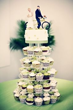 i love this with a different flavored cupcakes and without the topper.  But definitely still a formal wedding cake!
