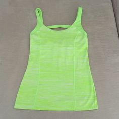 Victoria's Secret VSX Workout Top Victoria's Secret VSX Workout Top. Size XS. Lime green and white with line green detail. 77% nylon/23% spandex. EXCELLENT CONDITION - like new!! No trades. Victoria's Secret Tops Tank Tops