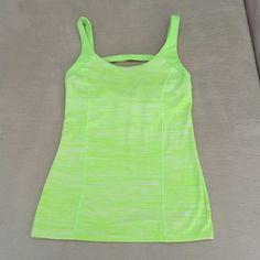 Victoria's Secret VSX Workout Top Victoria's Secret VSX Workout Top. Size XS. Green and white with green detail. 77% nylon/23% spandex. EXCELLENT CONDITION - LIKE NEW!! No trades Victoria's Secret Tops Tank Tops