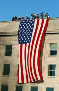 this brings back memories from the 1st anniversary of 9/11.  We were at the site listening to the names being read and this flag was behind us on one of the buildings.  On the top of the building was a lot of police and media.  It was quite windy that day and the wind kept whipping the flag on the media.  We laughed that this was a result of those whom we lost that day throwing the flag on the cameras so we could remember in peace.