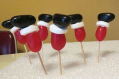 You can make these fun Santa Legs Cupcakes using Jelly Beans & Life Savers as Toppers. Be sure to view the Christmas Pull Apart Cupcakes as well! Christmas Gingerbread House, Christmas Party Food, Xmas Food, Christmas Sweets, Christmas Cooking, Christmas Goodies, Christmas Candy, Christmas Holidays, Gingerbread Village