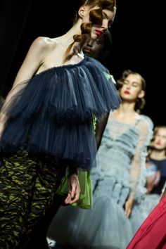 Dresses and separates in Molly Goddard's show at London Fashion Week were fabricated in feminine taffetas and tulles—those are SPACE designer Molly's weapons of choice.