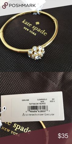 """Kate Spade Bangle Gold with stone flower design.  """"Putting on the Ritz"""" design. Never worn. Perfect Condition kate spade Jewelry Bracelets"""