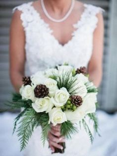 Winter wedding ideas christmas greens with pine cones white roses, could add red/ centralfloridaweddingflowers/ www.callaraesfloralevents.com