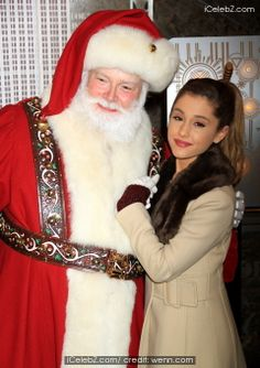 Ariana Grande and #SantaClaus light up the Empire State Building  See More Pic. http://www.icelebz.com/events/ariana_grande_and_santa_claus_light_up_the_empire_state_building/