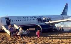 Passengers evacuate US Airways Flight 1702 in Philadelphia after the pilot was forced to abort takeoff when a tyre on the plane's front landing gear blew out