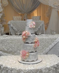 Dove Grey romantic elegance wedding cake.  Clusters of sugar roses, peonies adorn this beauty made by cakeglam.com
