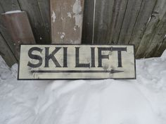 Hand Painted on wood (pine), Distressed Ski Lift Sign customize colors can be made to match your decor. Shown is Cream with black lettering. These are hand lettered the old fashion way, not vinyl or a stencil. Painted on pine. Measures approx 36 x 11 1/2 I paint every sign to order, so please allow time for me to make it, usually about 5 days  you can choose which direction you would like it to point