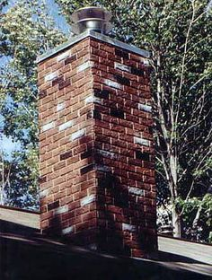 Beautiful DIY chimney designs made possible with faux brick or stone. See photos of what's possible to remodel and revitalize your own home. Faux Brick Panels, Brick Paneling, Brick Flooring, Home Fireplace, Fireplace Mantels, Chimney Cap, Brick And Stone, See Photo, Curb Appeal