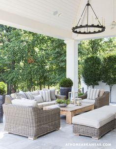 """There are simple design techniques and accessories that you can utilize to make your patio a fun entertainment space."" Image via At Home In Arkansas"