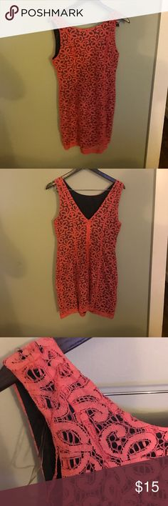 Pink lace dress Never worn. Not sure how the snag happened but it can be cut or pulled through. Very cute and flattering. Lined with black. Says large but it fits like a small or medium Dresses Mini