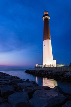 The Barnegat Lighthouse along Barnegat Bay starts to do it's job as night rolls in at the shore.