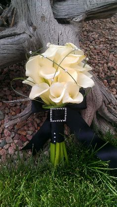 wedding bouquet of white calla lilies and bear grass with beautiful rhinestone buckle.  Bouquet by Secret Window
