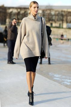 Forget tucking in, an oversize sweater and ankle boots are on trend and cozy.   - HarpersBAZAAR.com